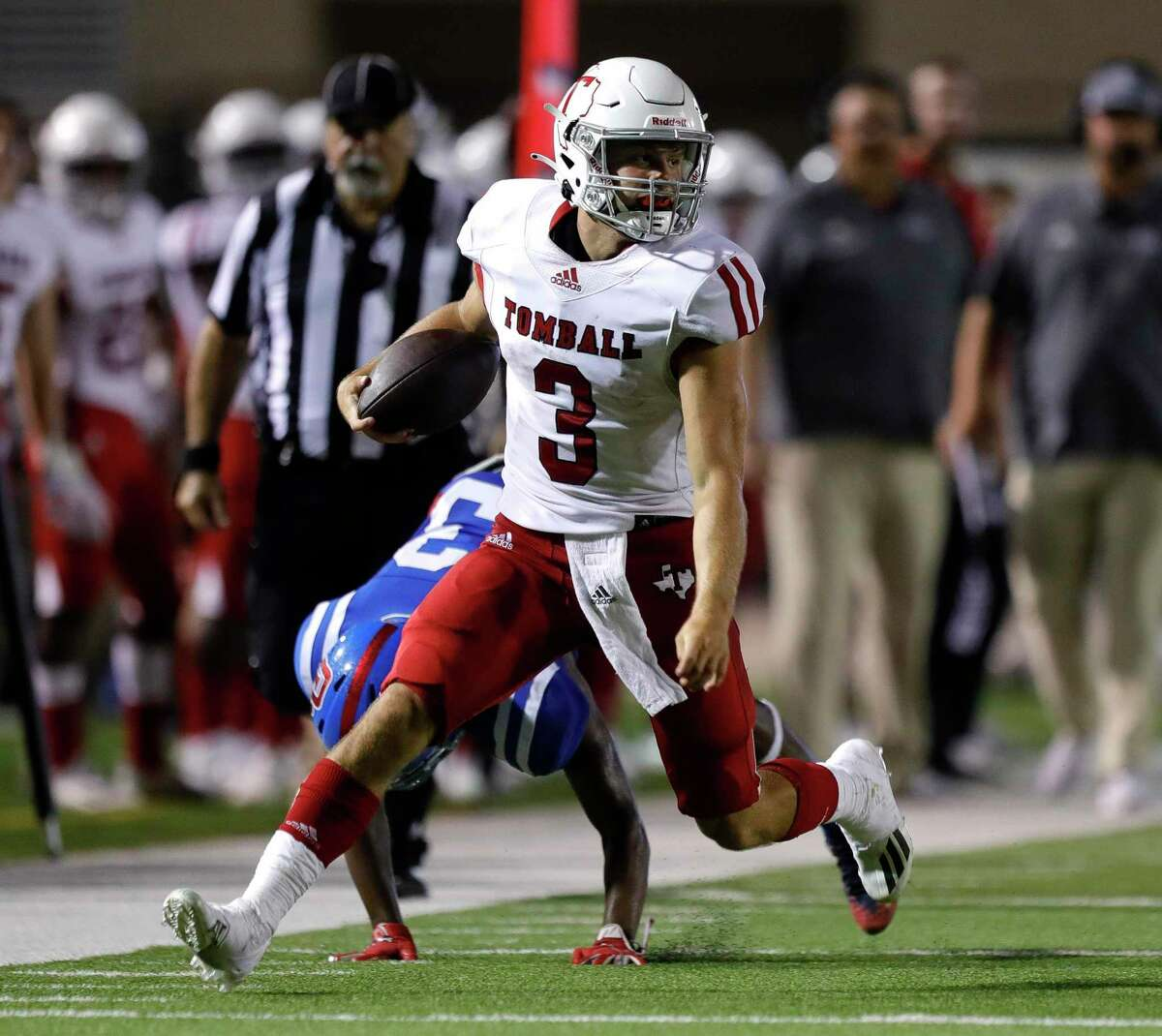 Tomball quarterback Cale Hellums (3) picks up a first down during the third quarter of a non-district high school football game at Woodforest Bank Stadium, Thursday, Sept. 16, 2021, in Shenandoah.