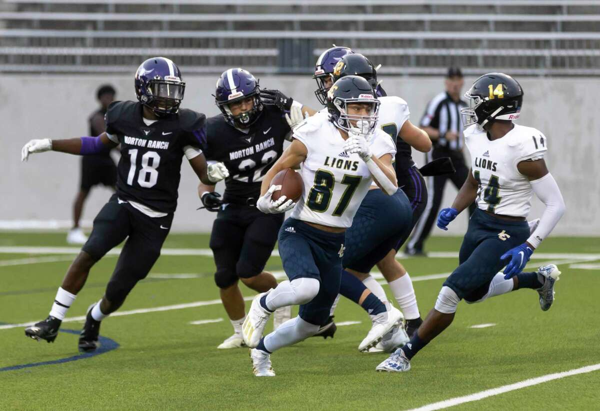 Lake Creek wide receiver Kolbey Wisnieske (87) runs the ball through Morton Ranch defense during the first quarter of a a non-district football game at Legacy Stadium, Thursday, Sept. 16, 2021, in Katy.
