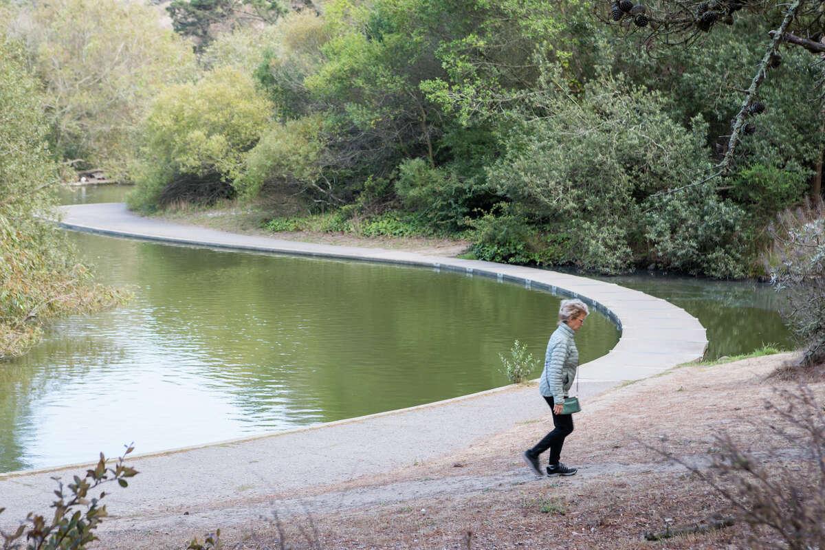 A woman walks through McLaren Park in San Francisco, Calif. on Sept. 16, 2021.