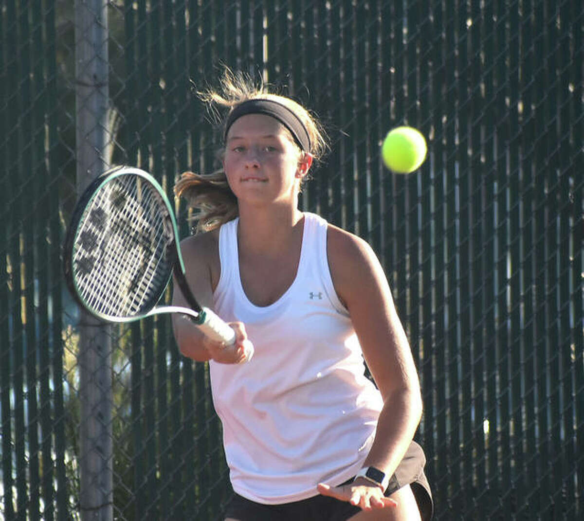 Edwardsville's Zoe Byron hits a return shot during her No. 3 singles match against Belleville East on Thursday inside the EHS Tennis Center.