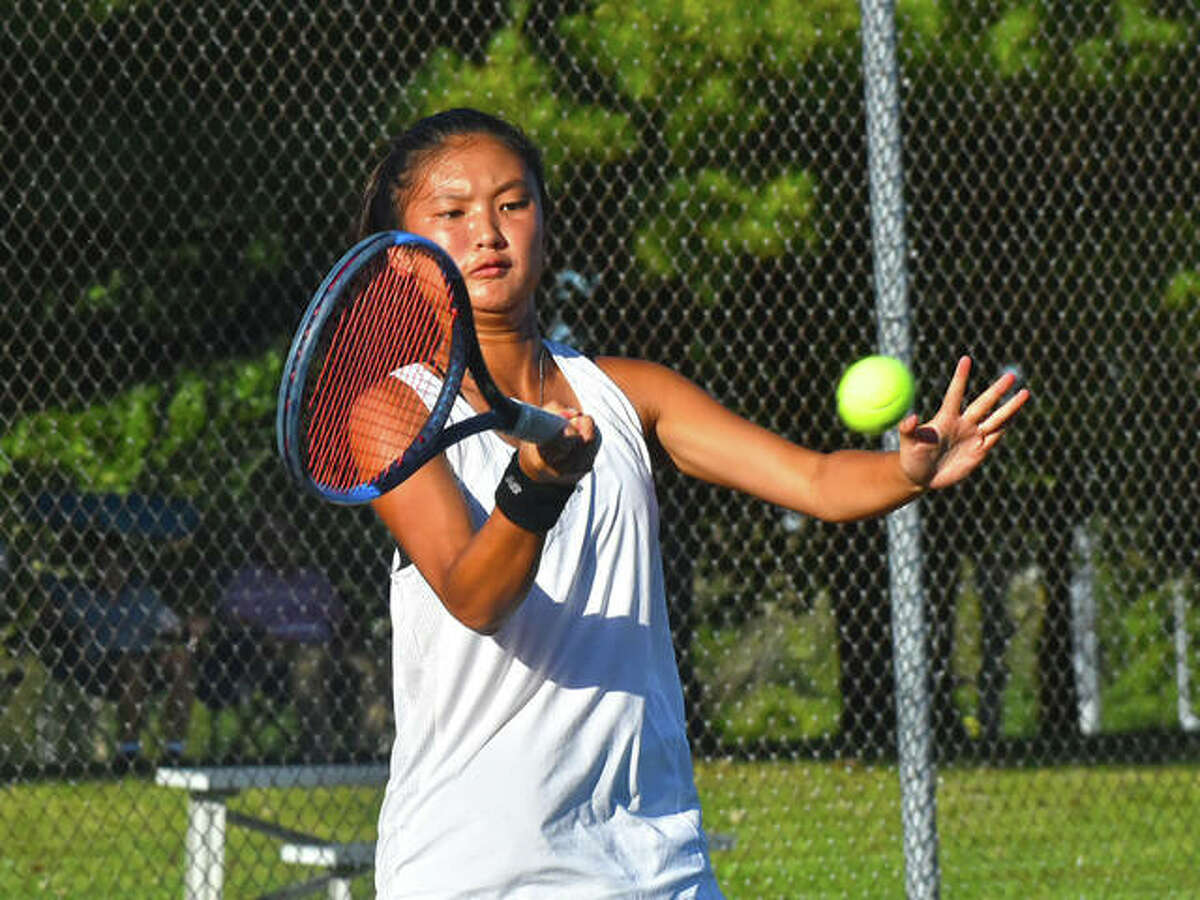 Edwardsville's Chloe Koons hits a forehand shot during her No. 1 singles match against Belleville East on Thursday inside the EHS Tennis Center.