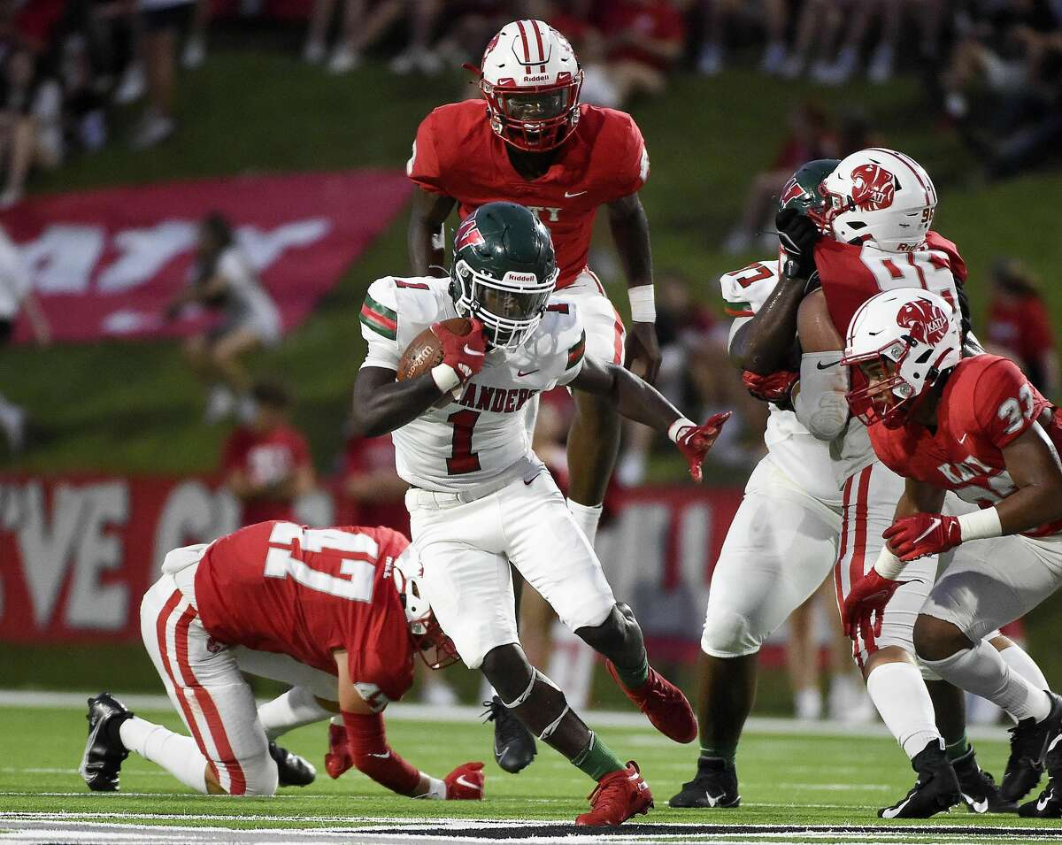The Woodlands running back JoBarre Reed (1) rushes the ball during the first half of a high school football game against Katy, Thursday, Sept. 16, 2021, in Katy.