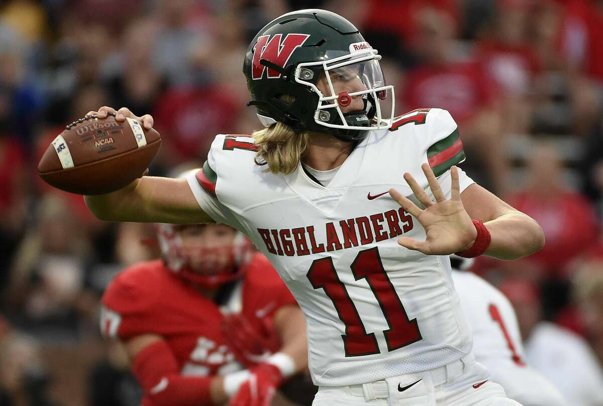The Woodlands quarterback Mabrey Mettauer throws a pass during the first half of a high school football game against Katy, Thursday, Sept. 16, 2021, in Katy.