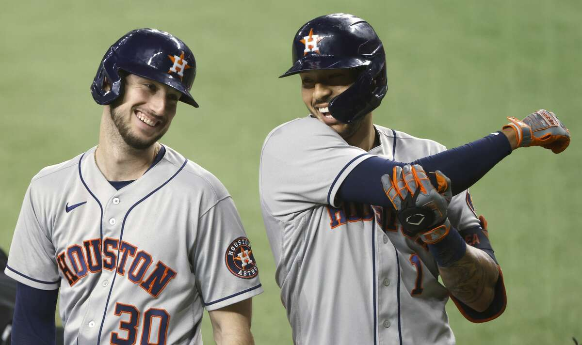 ARLINGTON, TX - SEPTEMBER 16: Carlos Correa #1 of the Houston Astros celebrates with teammate Kyle Tucker #30 after hitting a three-run home run against the Texas Rangers during the fourth inning at Globe Life Field on September 16, 2021 in Arlington, Texas. (Photo by Ron Jenkins/Getty Images)