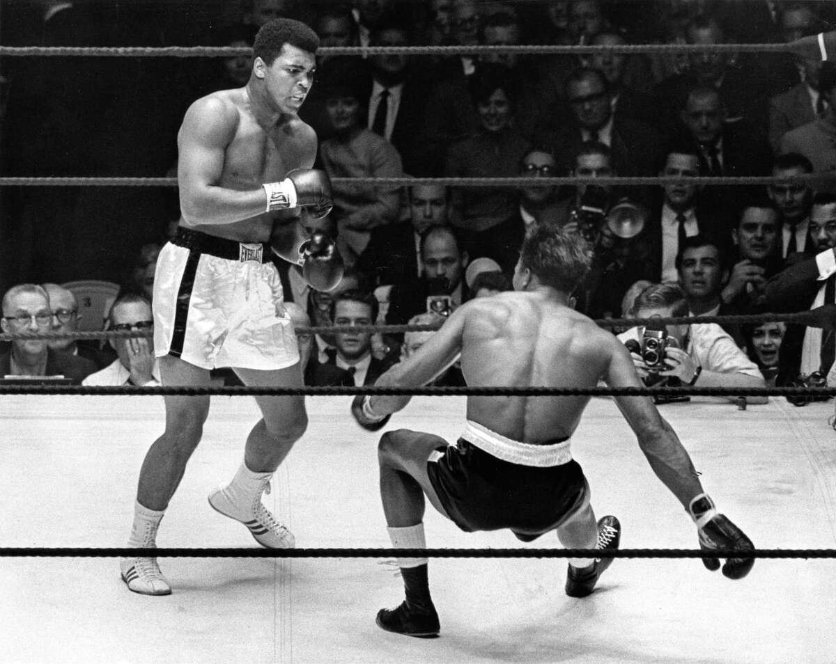Boxer Cassius Clay (aka Muhammad Ali) knocks Cleveland (Big Cat) Williams to the canvas for the fourth time in third round of their heavyweight title fight at the Astrodome, November 14, 1966. Moments later referee Harry Kessler put a stop to the mismatch of the scheduled 15-round encounter.