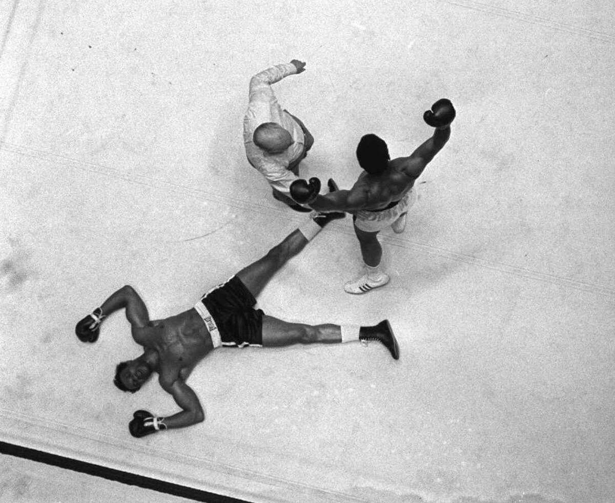 FILE-- Cleveland Williams is spread eagled on the canvas as referee Harry Kessler sends Cassius Clay to a neutral corner during their heavyweight bout at the Astrodome in Houston, in this Nov. 14, 1966 photo. Williams died of injuries in an auto-pedestrian accident Friday Sept. 10, 1999 in Houston. (AP Photo/File)