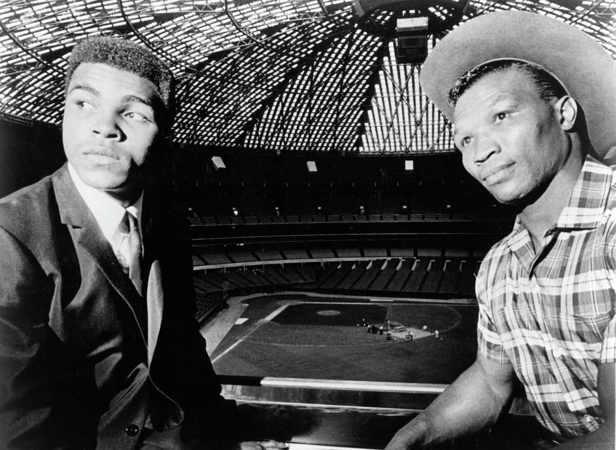 boxers Cassius Clay (aka Muhammad Ali) and Cleveland Williams at the Astrodome for official contract signing for fight, September 1966. The heavyweight title bout is to take place at the dome November 14, 1966.