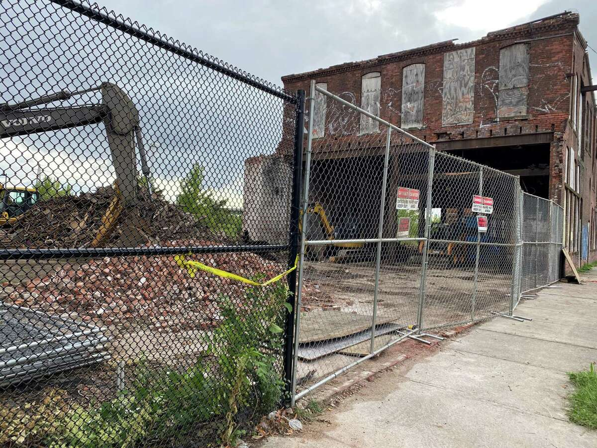 A portion of the Bigelow Building at 198 River St. in New Haven was demolished this week with more scheduled to come down.