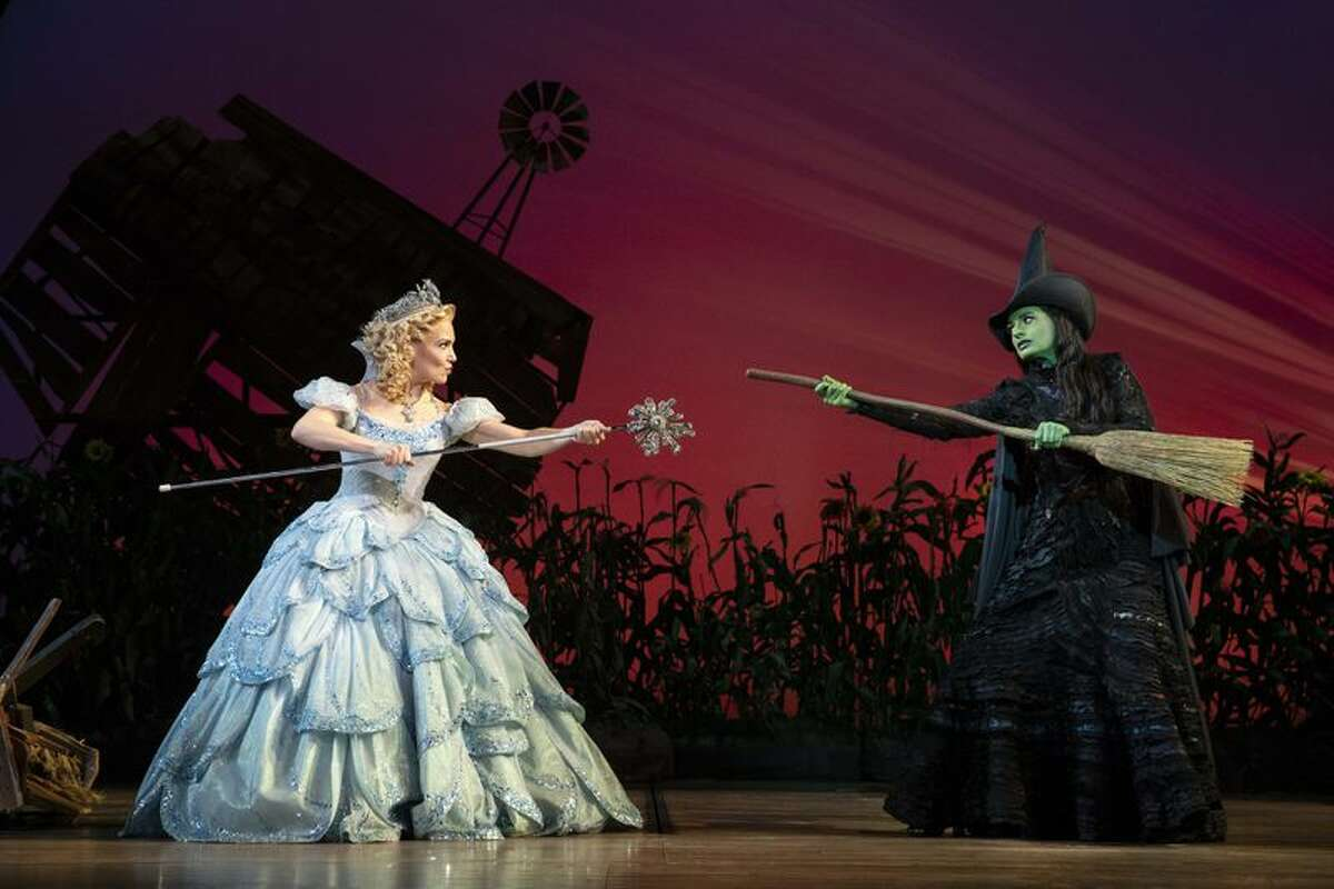 """Jackie Burns (left) performs on stage with Kara Lindsay in """"Wicked."""" Burns is one of the performers available through the Broadway Song Shoppe."""