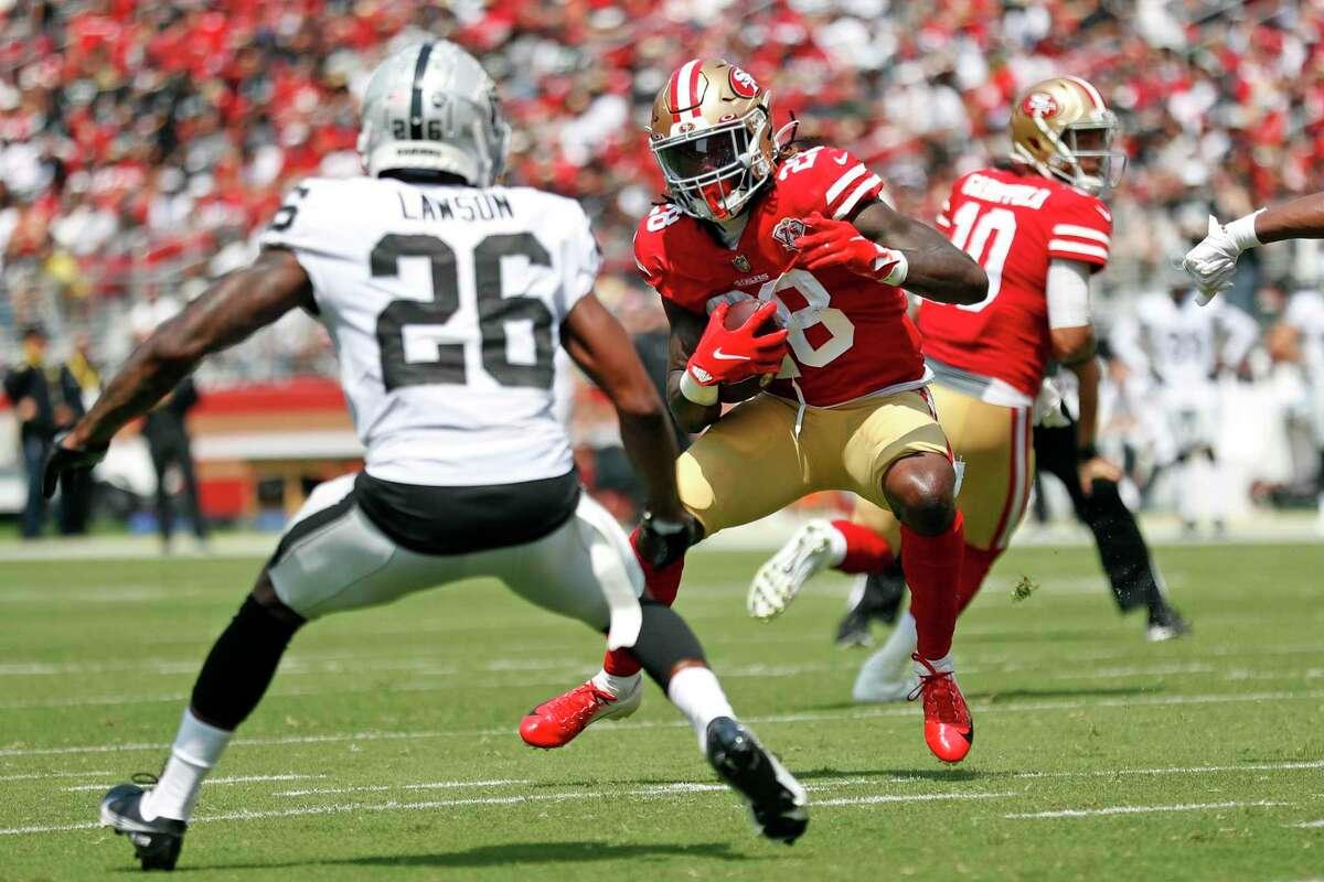 San Francisco 49ers' Trey Sermon rushes in 2nd quarter of 34-10 win over Las Vegas Raiders during NFL preseason game at Levi's Stadium in Santa Clara, Calif., on Sunday, August 29, 2021.