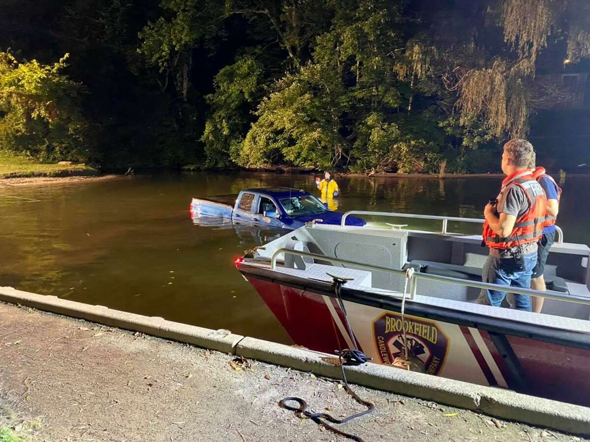 Firefighters responded to a vehicle in the water at Lattins Cove Wednesday, according to the Brookfield Volunteer Fire Department.