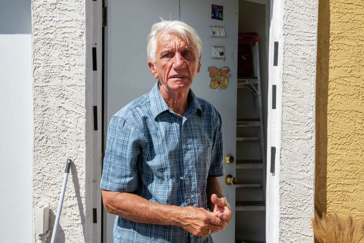 Ronald Opachinski, who lived with Anderson for eight years until her death in December, stands outside the apartment they shared in Mesa.