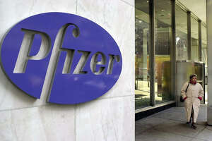 FILE - This 07 February 2000 file image shows pharmaceutical giant Pfizer's New York headquarters.(Photo credit should read HENNY RAY ABRAMS/AFP via Getty Images)