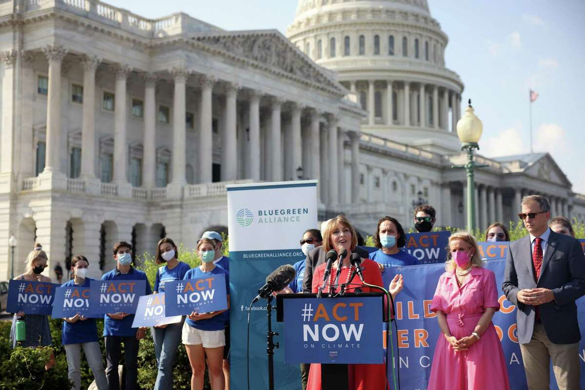 Members of Congress speak on infrastructure and climate change during a news conference outside the Capitol on Aug. 23 in Washington, D.C.