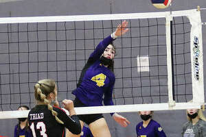 CM's Lexi Biciocchi (4), shown attacking before Triad can get a block up in last weekend's Alton Tourney, had seven kills Thursday night in the Eagles' MVC loss at Waterloo.