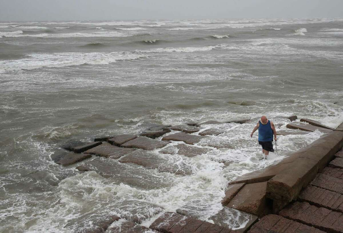 John Pittman, a nurse who works in emergency medicine, fishes to decompress along the seawall in Galveston as Tropical Storm Nicholas heads toward the Texas coast. Nicholas made landfall as a Category 1 hurricane near the eastern part of Matagorda Peninsula around 12:30 a.m. Tuesday, Sept. 21, 2021.