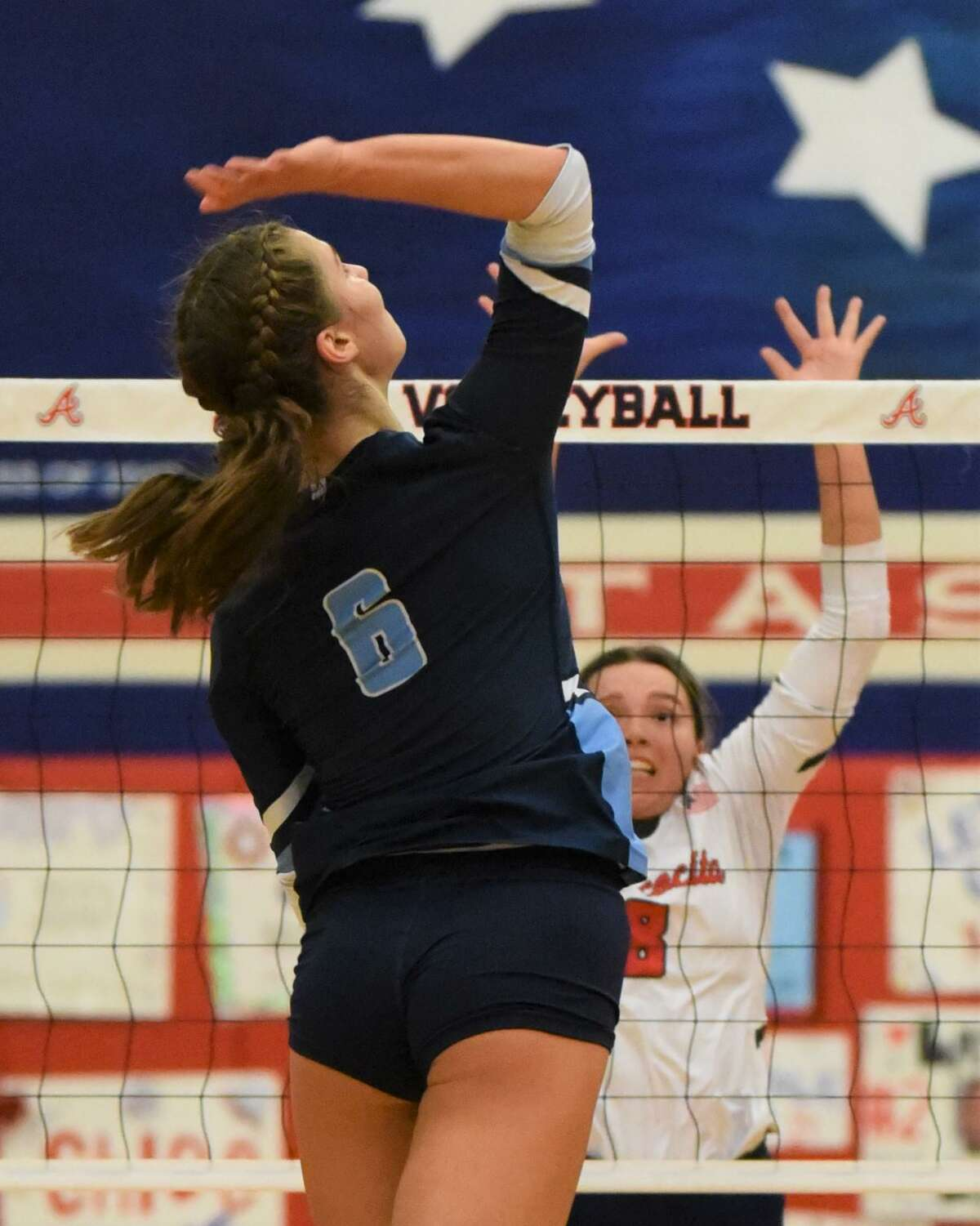 Kingwood senior outside hitter Sophie Ocampo goes up for a kill against Atascocita in a District 21-6A match at the Atascocita gym.