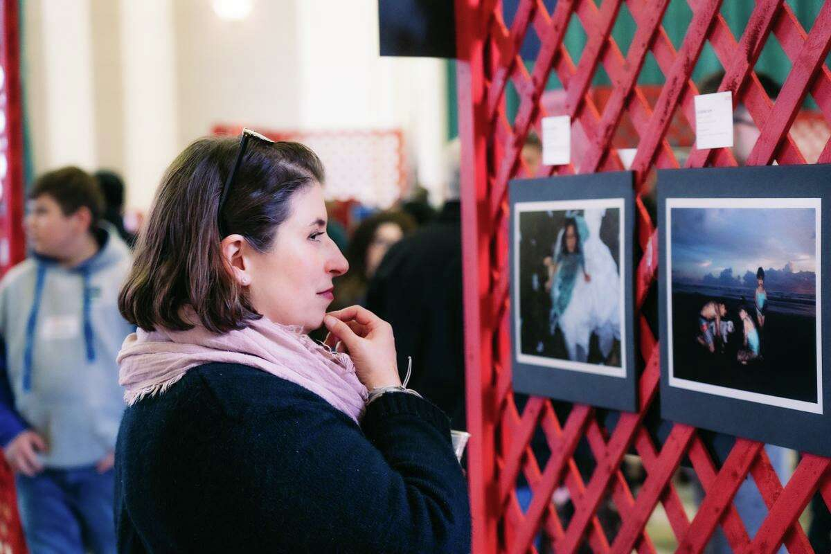 Entries are now being accepted for ASAP's Celebration of Young Photographers. Pictured, a guest looks at an exhibit from the 2019 contest.