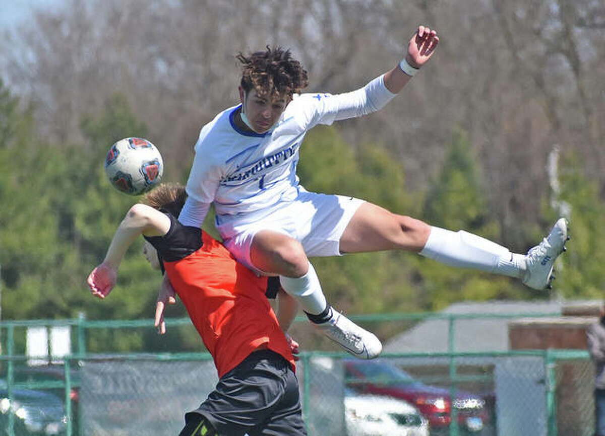 Marquette's Myles Paniagua, top, scored three goals for Marquette Catholic High in Thursday's 11-1 win over Metro-East Lutheran. He is shown colliding with an Edwardsville player in mid-air in an earlier 2021 game.
