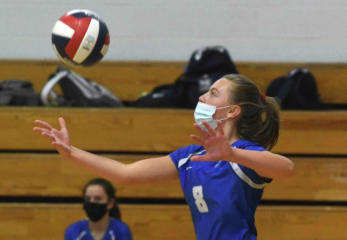 Darien's Aubrey Moore (8) serves the ball during a volleyball match against Newtown in Darien on Monday, Sept. 13, 2021.
