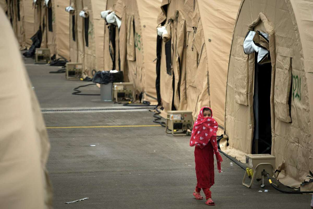 FILE - Temporary living facilities for Afghan evacuees at Ramstein Air Base in Germany on Aug. 30, 2021. Tens of thousands of Afghans hoping to be resettled in the United States remain on bases. (Gordon Welters/The New York Times)