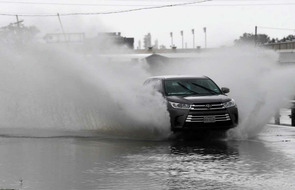 Vehicles make their way through a flooded portion of Martin Luther King, Jr., Blvd. as heavy rainfall and high winds persisted through the morning into afternoon as Tropical Storm Nicholas moved through the region. Photo made Tuesday, September 14, 2021 Kim Brent/The Enterprise