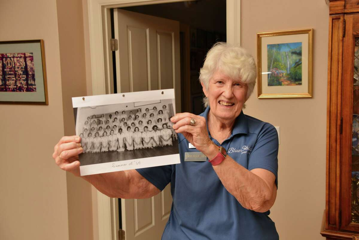 Ginny Hallager of San Antonio was one of 43 cadets in a Navy Officer Candidate School-W class in 1964. She is the fourth from the right in the front row of her class picture.