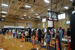 People line up to receive the COVID-19 vaccine in Milford in May.