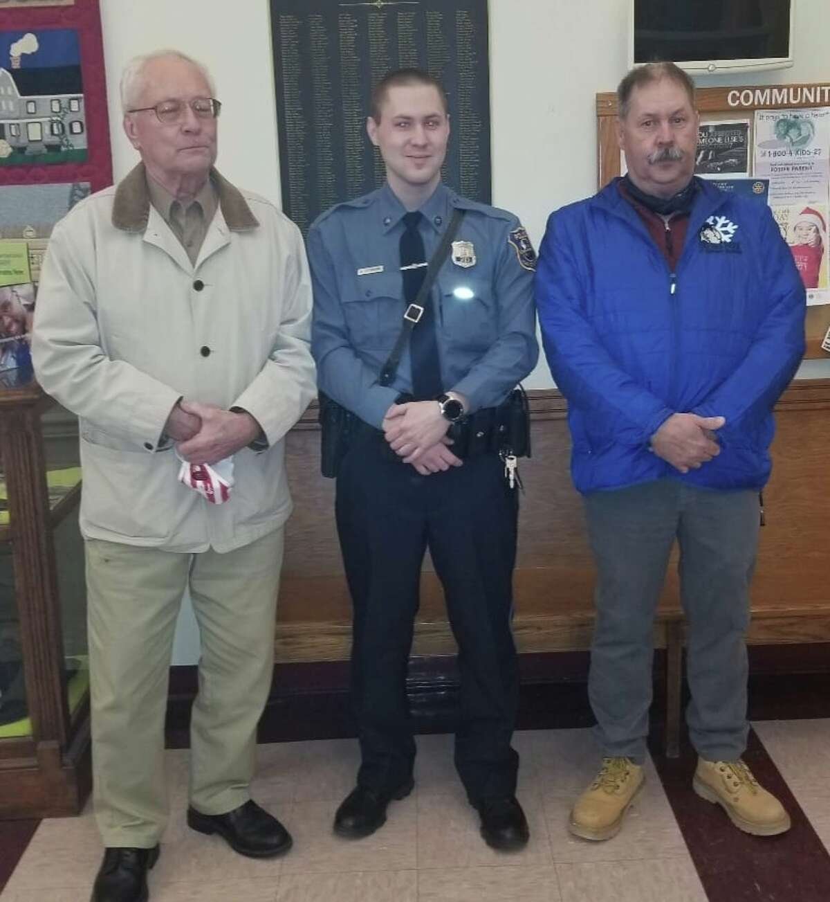Police officer Christopher Cockburn, right, of Goshen died on Tuesday, Sept. 14 from COVID-19. He's pictured with his father-in-law and retired police officer Stanley Lupinski, left, and his son Andrew, middle.
