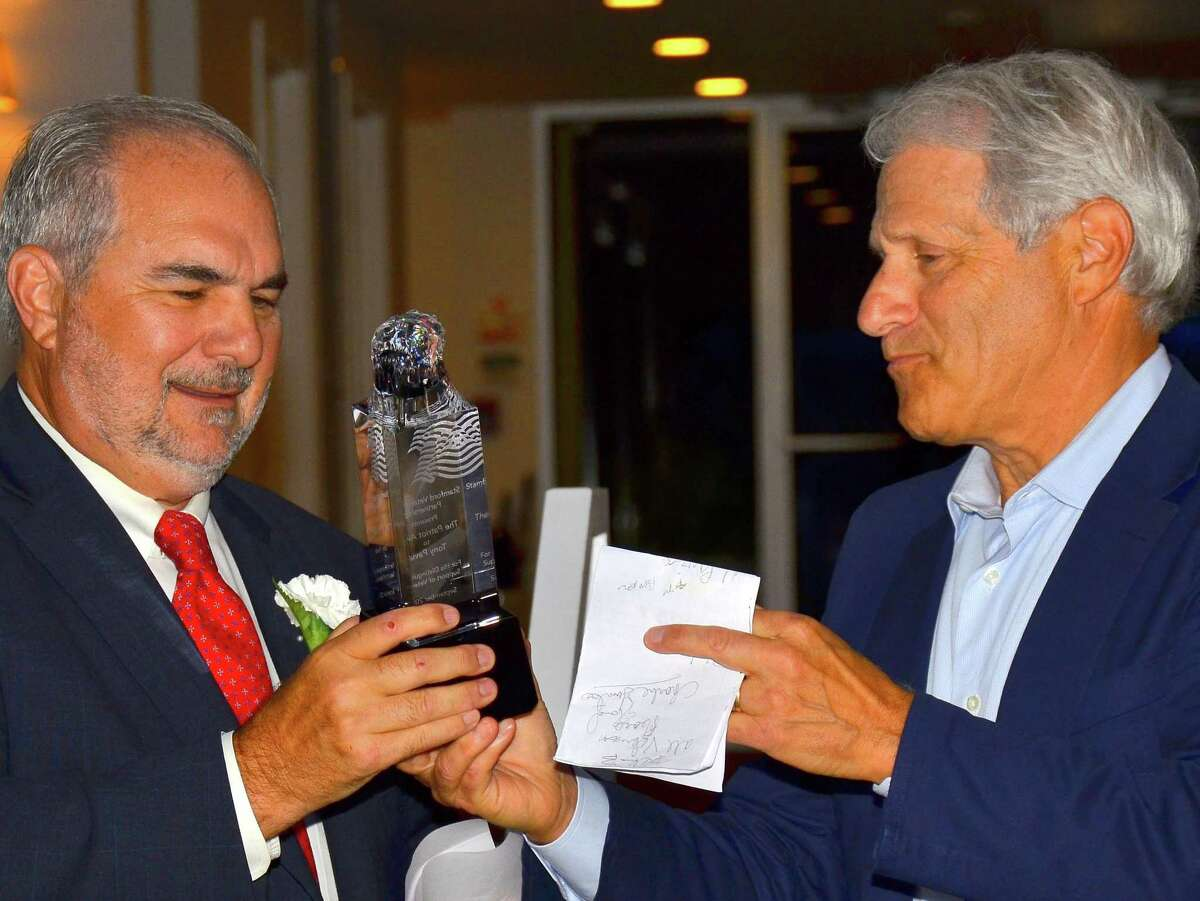 Tony Pavia accepts the Stamford Veterans Park Partnership's Patriot Award from SVPP President Richard Redniss on Sept. 9, 2021, at the Woodway Beach Club in Stamford.