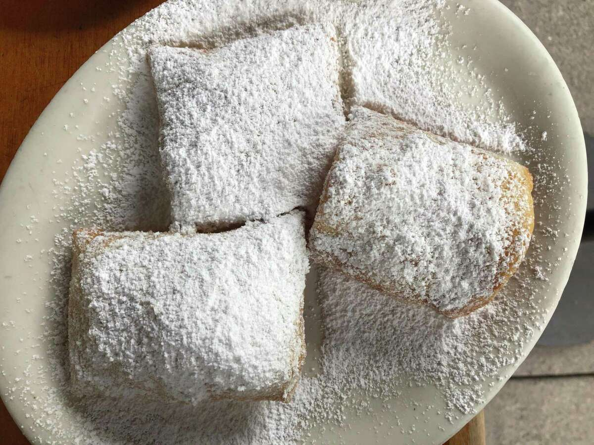 Beignets sprinkled with powdered sugar at Just For You Cafe in San Francisco.