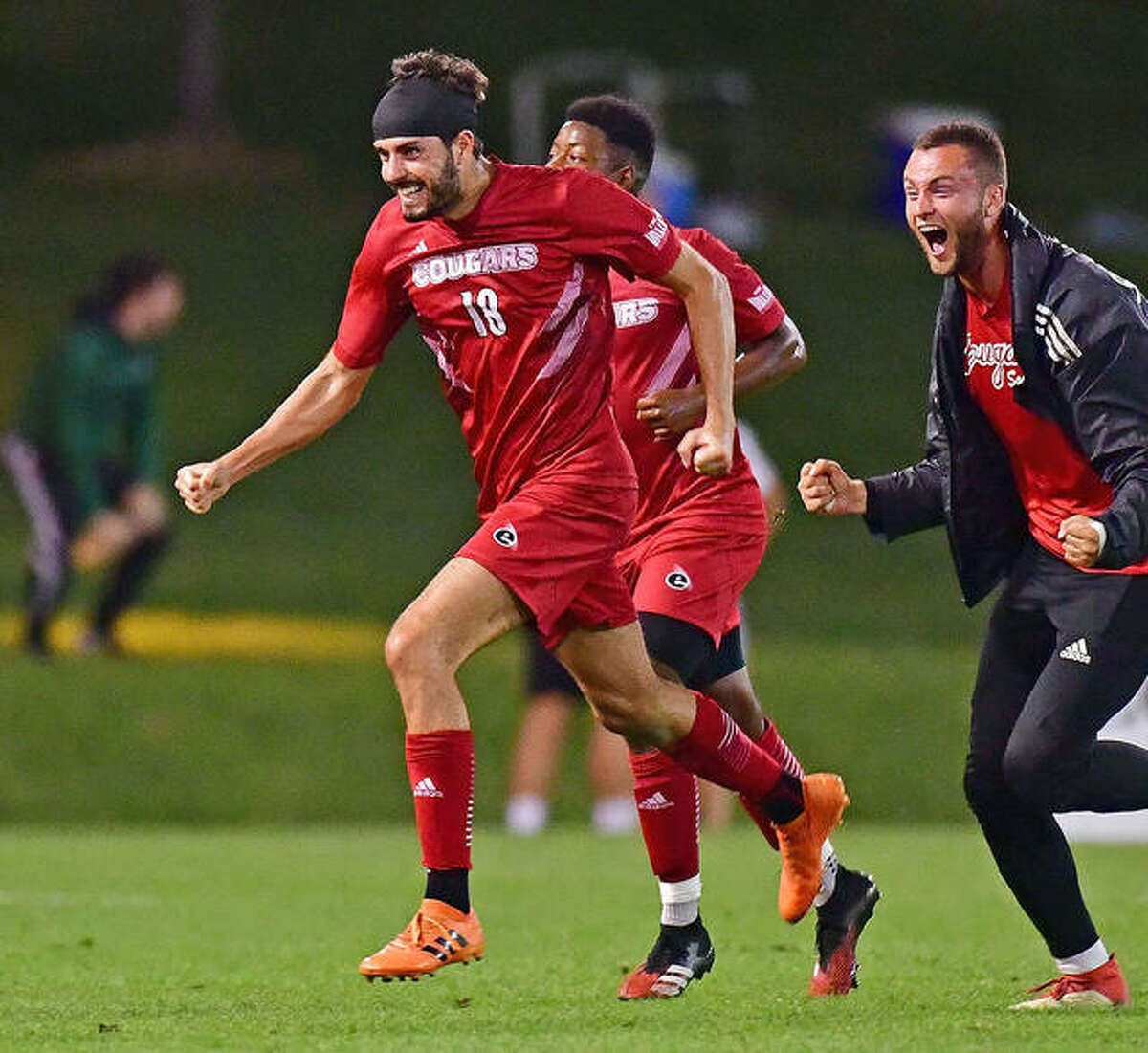Pau Palacin of SIUE and teammates celebrate his second-half goal that pulled the cougars into a 1-1 tie with Saint Louis University in the 30th Bronze Boot soccer game Tuesday night at Hermann Stadium