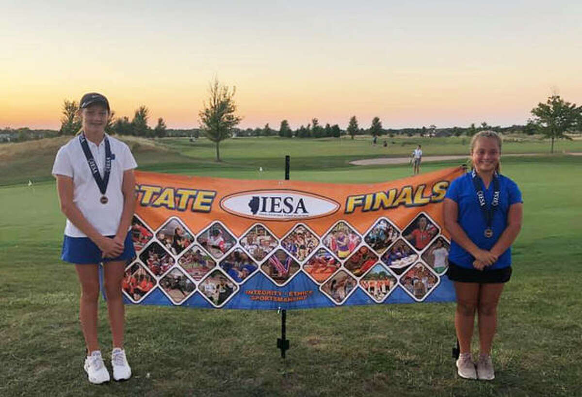 Liberty Middle School's Rachel Johnson, left, and Ally Suhre each finished in the top 10 at the IESA girls state golf tournament on Thursday at Metamora Fields. Johnson, the younger sister of EHS junior Nicole Johnson, fired a 72 to finish in third place. Suhre, the younger sister of EHS sophomore Drew Suhre and freshman Ryan Suhre, fired an 84 to finish in ninth place. Northbrook Wood Oaks' Martha Kuwahara won the tournament with a 70. Johnson is an eighth-grader. Suhre is a seventh-grader.