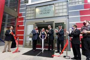 Celebrating with a ribbon cutting at the newly re-opened Discovery Center are from left are Bridgeport Regional Business Council President and CEO Dan Onofrio, Sacred Heart University President John J. Petillo, Discovery Executive Director Erika Eng, Discovery Chairman Robert A. Panza, Farrington College of Education Dean Michael Alfano and Discovery staff Saturday morning, September 17, 2021.