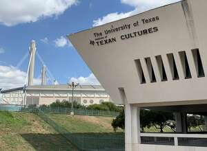 The entrance to the Institute of Texan Cultures, backdropped by the Alamodome.