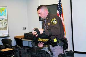 In this photo from 2017, Deputy Jason Traeger, of the Manistee County Sheriff's Office, tries on his protective gear purchased with a Local Revenue Sharing Board grant. Traeger has taken on the role of truancy officer and police liaison at Bear Lake, Kaleva Norman Dickson and Onekama Consolidated Schools.