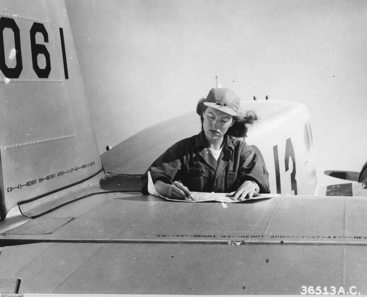 Founder of the Women's Air Force Service Pilot, Margaret Callahan, checks her card before a flight from Avenger Field in Sweetwater, Texas, in August 1943. Wasps have already trained in Houston.