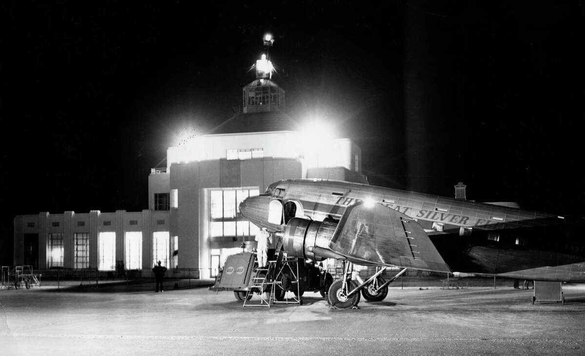 Mail and fuel enter a 21-passenger large Douglas for an overnight flight from Houston to New York on October 26, 1941.