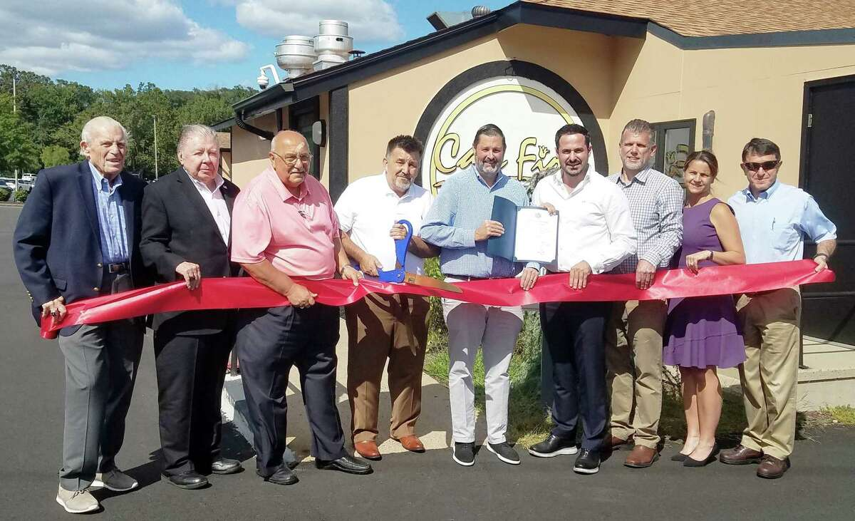 Café Fiore in Cromwell celebrated a grand opening Sept. 2. From left are Middlesex County Chamber of Commerce President Larry McHugh, Willowbrook Spirit Shoppe owner and former chamber chairman Jay Polke, Town Manager Anthony Salvatore, owner Rusit Cecunjanin, Mayor Enzo Faienza, restaurant manager Valon Avdimetaj, Cromwell Automotive owner and Cromwell Division Chairman Rodney Bitgood, state Rep. Christie Carpino, R-Cromwell; and Town Planner Stuart Popper.