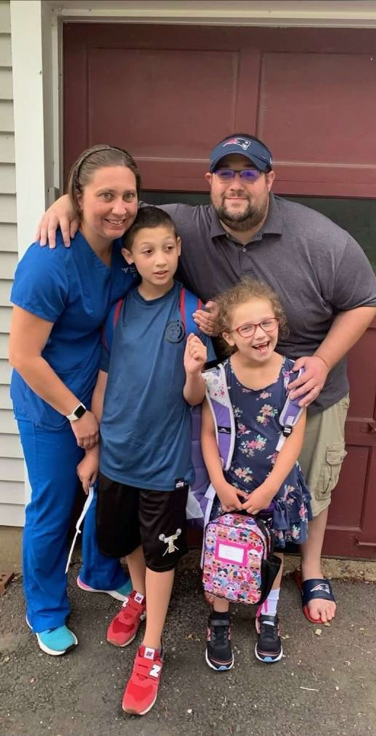 Ashley Balestriere, with husband Philip, hopes a vaccine trial can help her children Jimmy, 10, and Amy Ruth, 7, have a normal childhood.