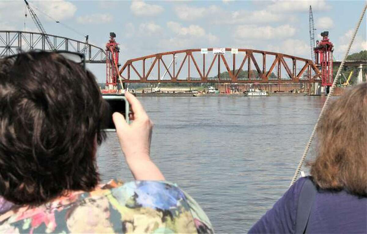 A riverboat cruise on Friday showed off the installation of the first of three new trusses for the Merchants Bridge. The bridge, built in 1889 and one of two operating rail bridges in St. Louis, is undergoing a $222 million rehab that will greatly improve efficiency.