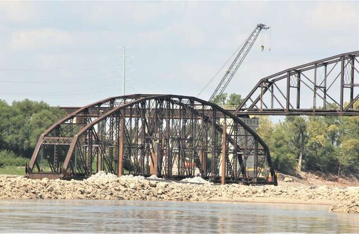 A truss from the Merchants Bridge that was removed as part of a $222 million rehabilitation project sits waiting to be scrapped. A riverboat cruise to look at the project from a rivers-eye view attracted about 200 participants Friday.