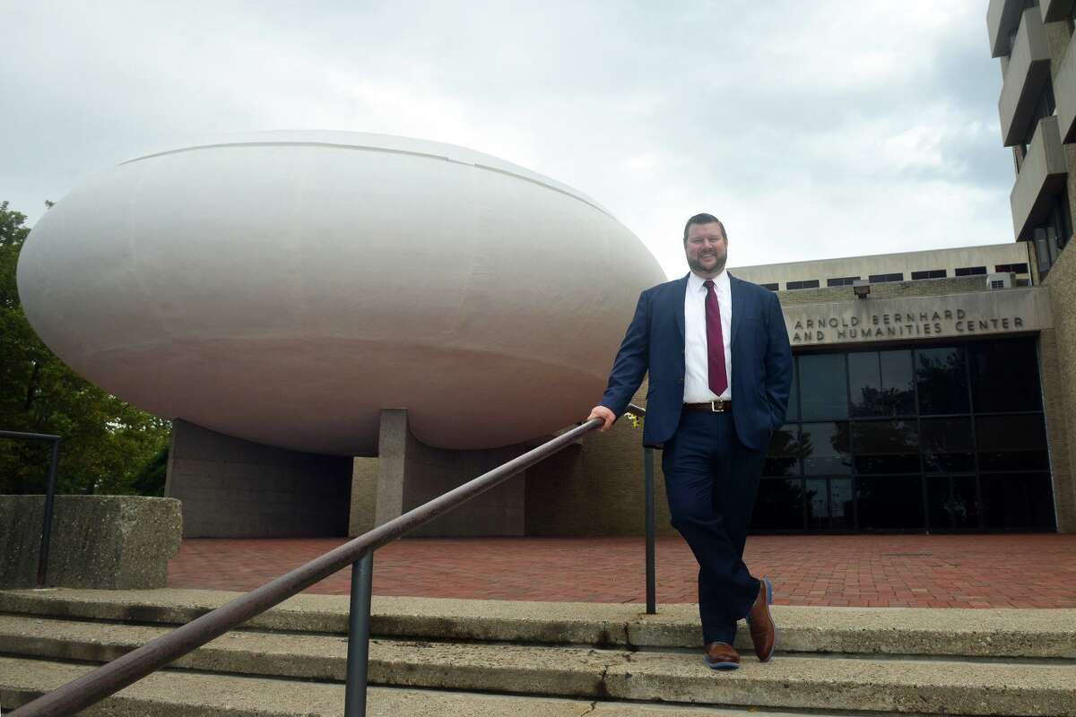 Joseph Bierbaum, President of Paier College, poses in front of the Bernhard Center, the school's new location that was formerly part of the University of Bridgeport campus, in Bridgeport, Conn. Sept. 16, 2021.
