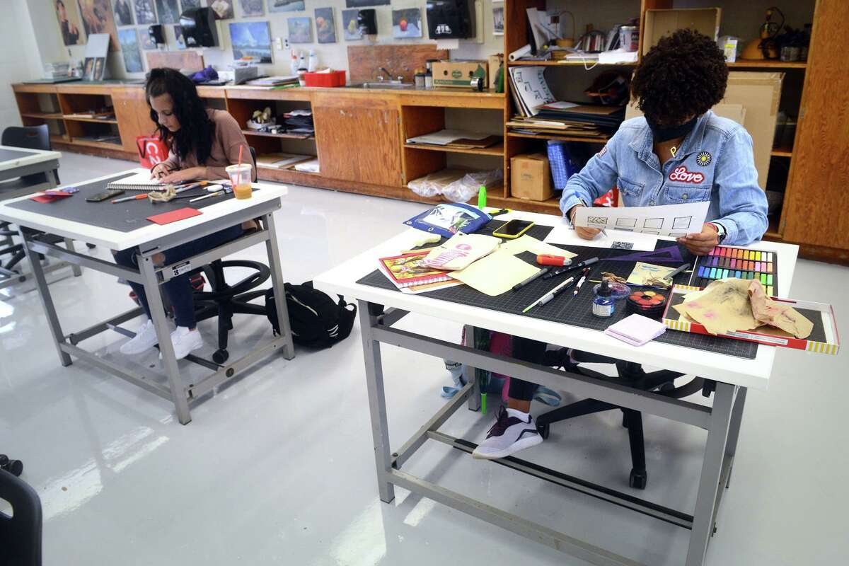 Alicia Marinuzzi, left, of North Haven, and Baola Suero, of Bridgeport, work during a two-dimensional design class at Paier College, in Bridgeport, Conn. Sept. 16, 2021.