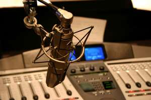 Radio station microphone in front of mixing board. DESIGNERS... I would love to have you sitemail me and let me know how you use this image! Thank-you !