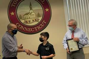 """Ten-year-old Nicky Zaccagno was named """"Bethel's Honorary Ambassador of Food"""" last Thursday at the municipal center. State Rep. Raghib Allie-Brennan, left, is pictured with Zaccagno, center, and First Selectman Matt Knickerbocker."""