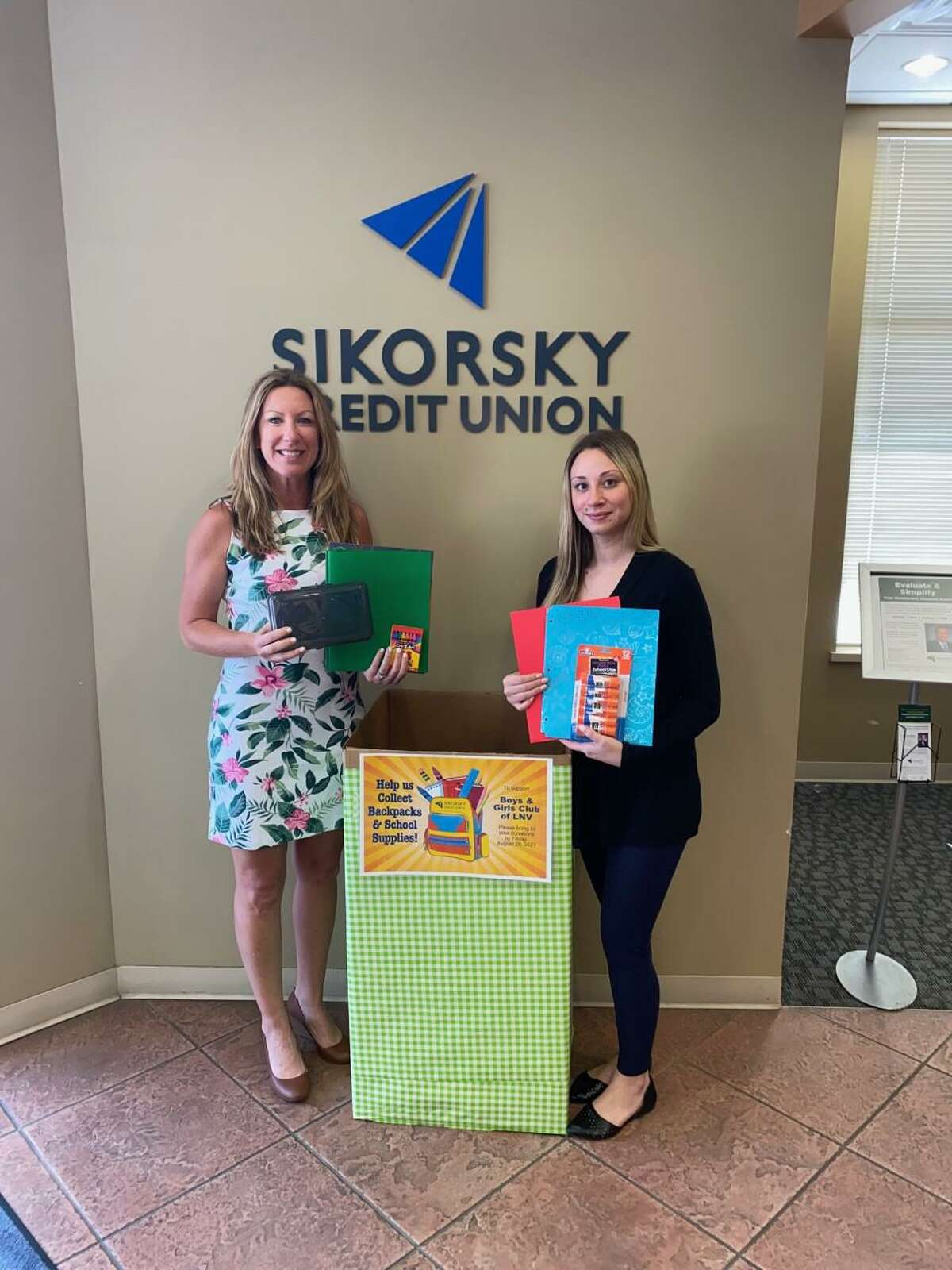 The Sikorsky Credit Union in Shelton recently organized Back-to-School drives at their branches to give back to children in their local communities. Pictured from the left to the right are: The Chief Executive Officer, (CEO), of the Boys & Girls Club of the Lower Naugatuck Valley, Shaye A. Roscoe, and the Branch Manager of the Sikorsky Credit Union's Branch office in Shelton, Maxine Jones.