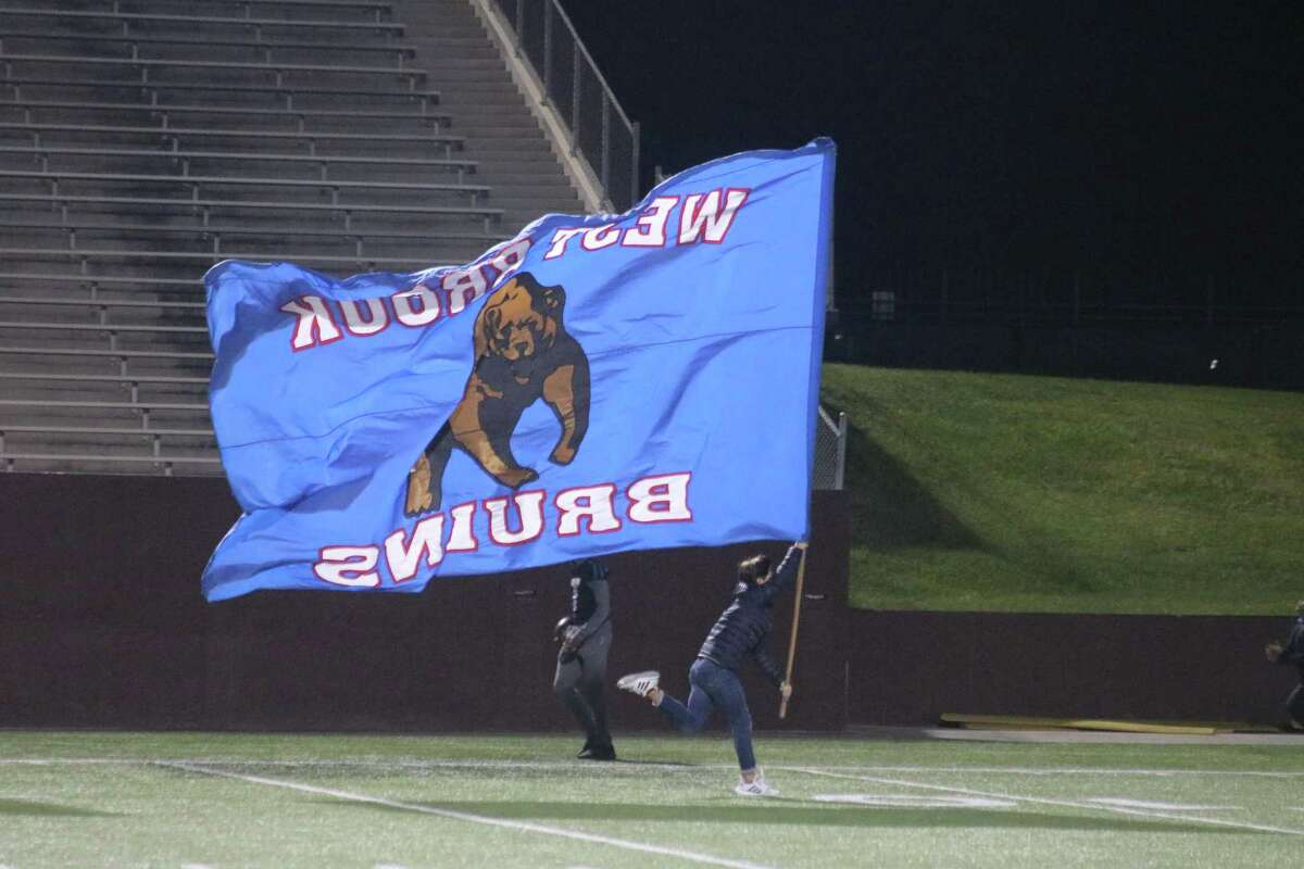 The West Brook flag is flown across the Clyde Abshier Stadium turf following a touchdown when the Bruins last invaded Deer Park in 2019. Tonight, they return for Deer Park's last non-district assignment.