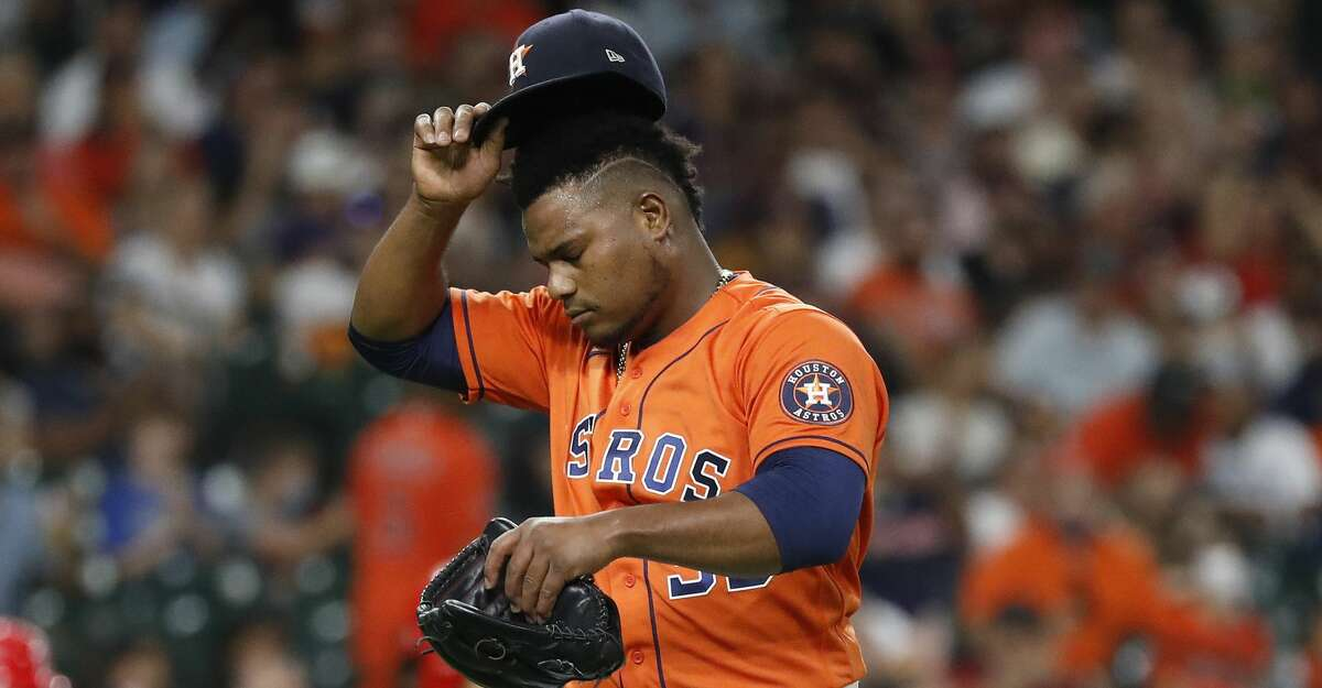 Houston Astros starting pitcher Framber Valdez (59) reacts after striking out Los Angeles Angels Phil Gosselin, with the bases loaded, ending the top of the fourth inning of an MLB baseball game at Minute Maid Park, Friday, September 10, 2021, in Houston.