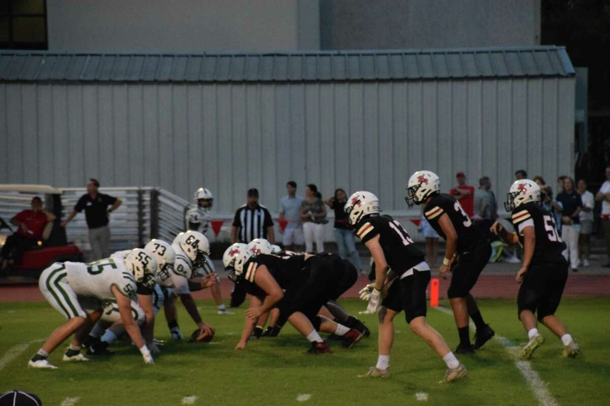 The St. John's defense. pictured here in black during the Maverick's Week 1 35-21 win over John Cooper, has helped the team get off to a 3-0 start